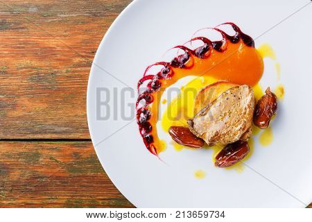Roasted goose liver with date, apple and fruit and berry sauce painting. Creative french cuisine, delicatessen restaurant meal