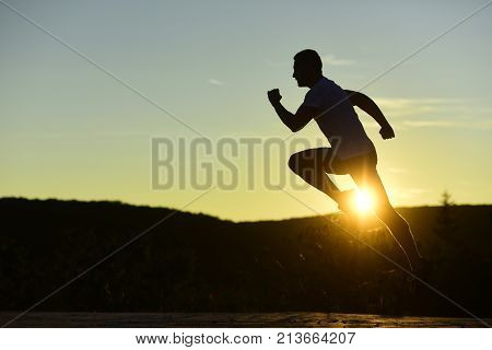 Man With Sportive Figure Practices Sport Running For Life.