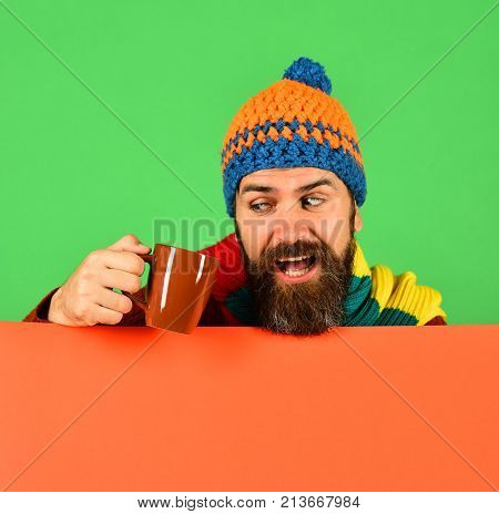 Caffeinated Beverages Idea. Man In Warm Hat Holds Brown Cup