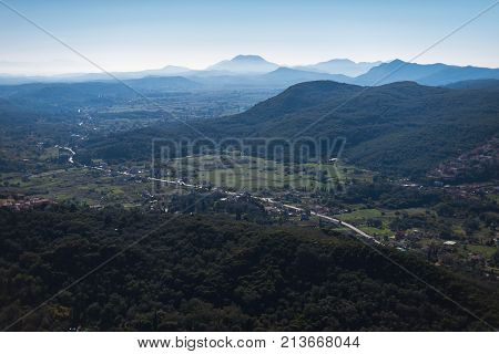 View Over Valley And Mountains In Hazy Sunlight. Corfu, Greece.