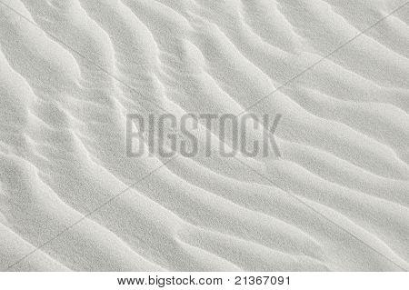 white sea sand texture on sunset