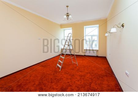 Interior of upgrade apartment with ladder after the remodeling renovation extension restoration reconstruction and construction. ( making wall from gypsum plasterboard)