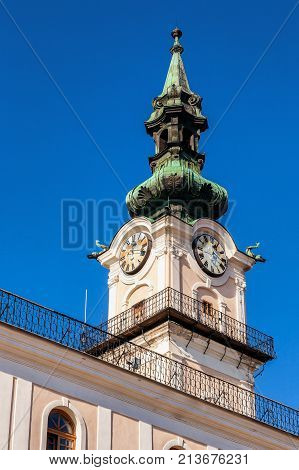 Tower with clock on historical baroque townhall in Kezmarok Spis region Slovakia.