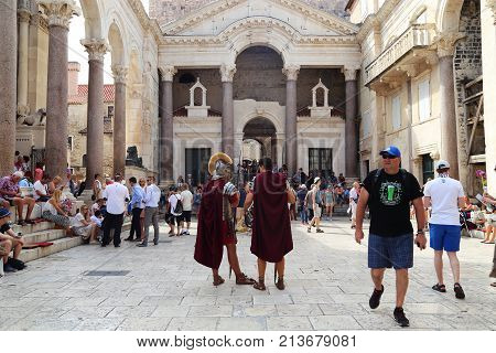 SPLIT, CROATIA - SEPTEMBER 11, 2016: It is the peristyle (courtyard) of the Palace of the Roman Emperor Diocletian which is filled with tourists and artists.