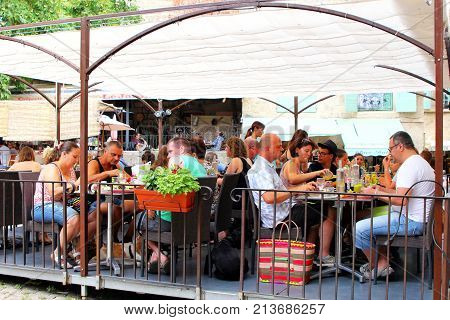 Pezenas, Herault, France - Aug 26 2017: Diners Enjoying Lunch In A Traditional French Outdoor Cafe O