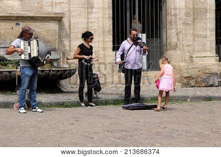 Pezenas, Herault, France - Aug 26 2017: Trio Of Street Musicians Performing In Pezenas, Languedoc, F