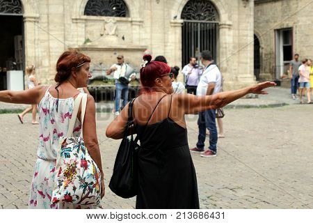 Pezenas, Herault, France - Aug 26 2017: Two Middle Aged Female Woman Tourists With Bright Hair And B