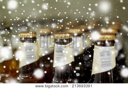 sale and alcohol concept - close up of bottles at liquor store over snow