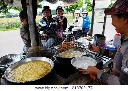 Vietnamese Woman Street Food Vendor