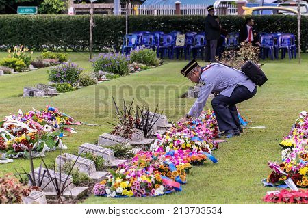 Labuan,Malaysia-Nov 12,2017:Scout leader laying a wreath of flowers during the Remembrance Day at Labuan War Memorial park in Labuan,Malaysia.