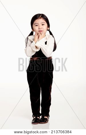 Studio full body of shy Asian girl