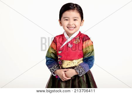 A studio portrait of an Asian girl in traditional costume of Korea