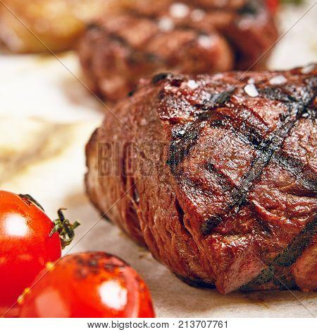 Gourmet Grill Restaurant Steak Menu - Various Grilled Beef Steak on Wooden Background. Black Angus Prime Beef Steak. Beef Steak Dinner. Top VIew