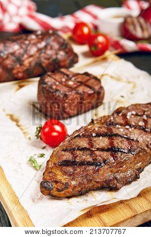 Gourmet Grill Restaurant Steak Menu - New York Beef Steak on Wooden Background. Black Angus Prime Beef Steak. Beef Steak Dinner. Top VIew