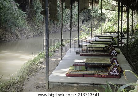 Outdoors seats beside the creek in summer stock photo