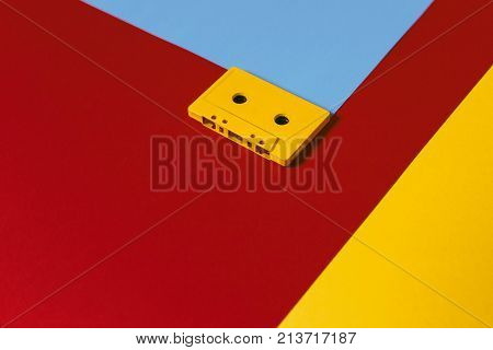 Yellow Audio Cassette Tapes On Colored Background Top View. Creative Concept Of Retro Technology