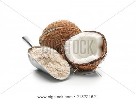 Scoop with coconut flour and nut on white background