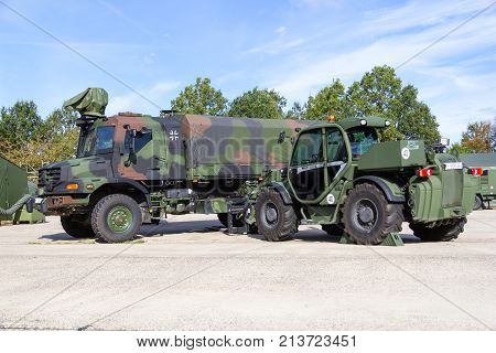 MUNSTER / GERMANY - OCTOBER 9 2017: Mercedes Benz Zetros truck and Manitou MHT 950 telescopic handler from german army stands on platform