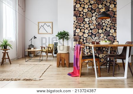Rustic Apartment With Table And Armchair
