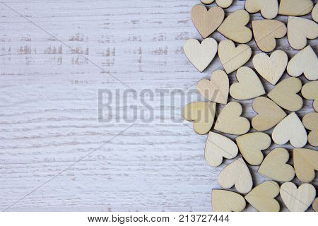 Heart shape from natural tree. Lovely heart shape by wooden small hearts on rustic wood table. Love theme concept with wooden hearts for Valentine's background and love theme. wooden leters i love you.