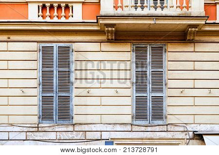 Two Windows Shut With Blue Shutters