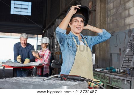 Young woman as apprentice worker in metallurgy apprenticeship