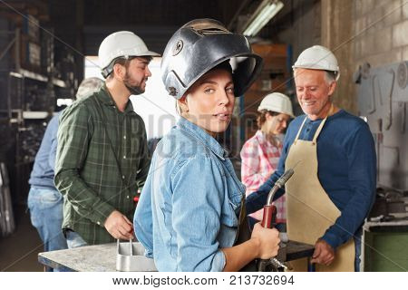 Young woman in apprenticeship lesson as blue collar worker