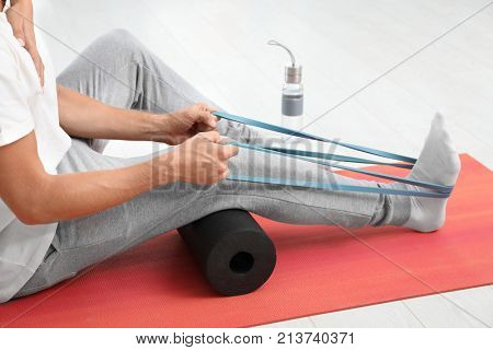 Patient doing exercise during physiotherapy session in clinic