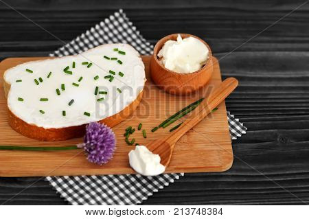 Cheese spread and chives on slice of bread