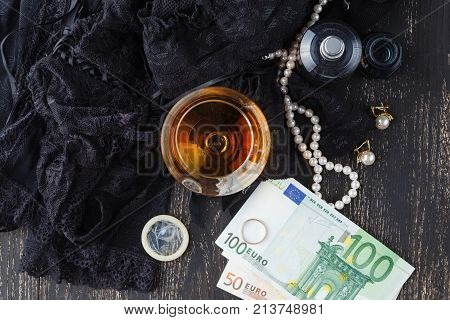 Underwear, Cognac And Money To Symbolize The Cost Of Sex