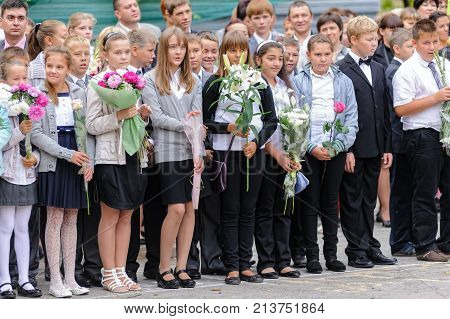Tyumen, Russia - September 1, 2012: School 43. School line is in schoolyard with pupils and teachers. Feast Day of Knowledge.