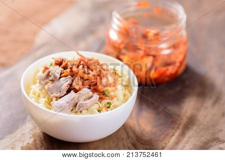 Korean food, instant noodle with kimchi cabbage in a bowl