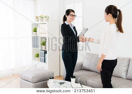 Friendly Business Lady With Her Client Handshake