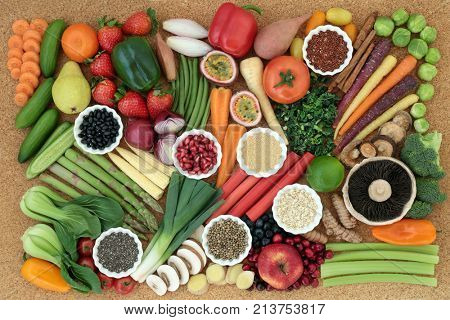 Super food for healthy diet concept with fresh vegetables, fruit, legumes, seeds, grains and cereals high in omega 3, anthocyanins, antioxidants, dietary fibre, vitamins and minerals. Top view.