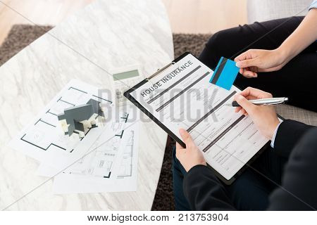 Woman Using Credit Card Buying House Insurance
