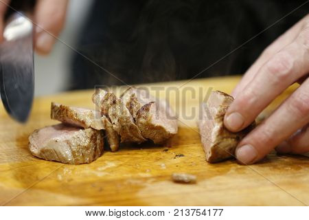 Knife Cuts Cooked Hot Meat.cut The Fried Meat. Ready Meat. Ready-made Hot Meat. Meat With Smoke