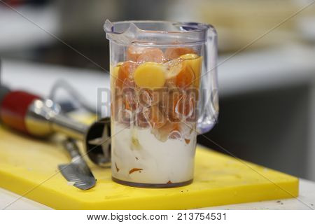 In A Glass Of Boiled Carrots And Eggs.carrot And Milk In A Blender. Mix The Ingredients