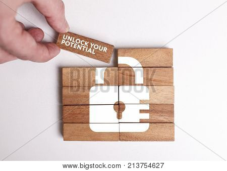 Business Technology Internet and network concept. Young businessman shows the word: Unlock your potential poster