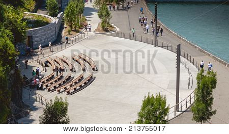 LOURDES FRANCE - June 22 2017 : pilgrims gather on the benches in front of the Grotto of Lourdes France