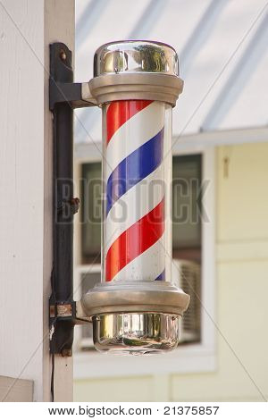 Classic Barber Pole On Wood Post