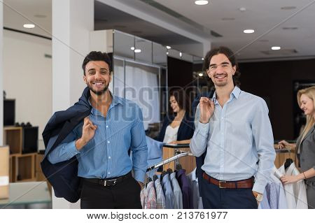 Two Happy Smiling Businessmen Wearing Elegant Suits Standing In Modern Menswear Retail Store, Successful Business Men Buy New Clothes