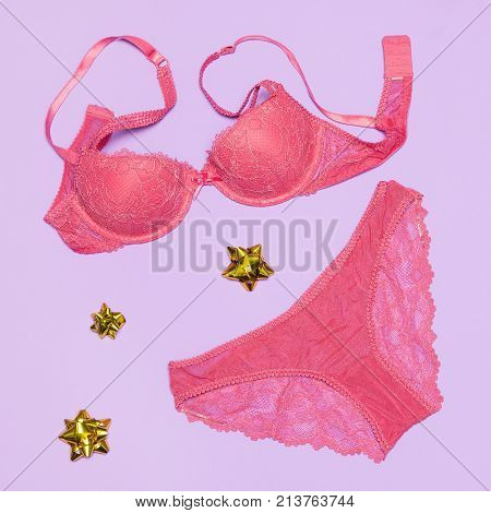 Underwear as gift for beloved woman. Sexy lace lingerie set of bra and panties with wrap bows