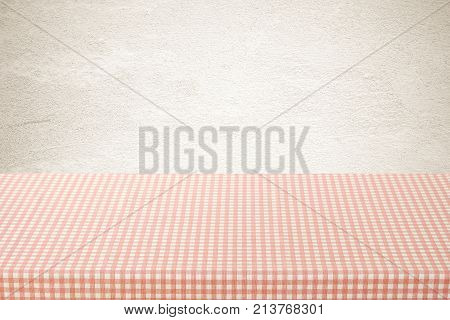 Empty table cover with pink and white tablecloth over brown cement wall background banner table top counter design for food and product display montage