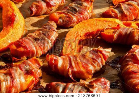 Pumpkin slices wrapped in bacon and baked in the oven till crispy