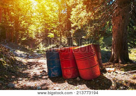 Toxic waste barrels in the forest environmental issue and ecology