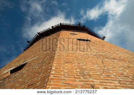 Close Up Faceted Tower Of Kremlin On Blue Sky Background Sunny Summer Day Bottom View. Kolomna Moscow Region.