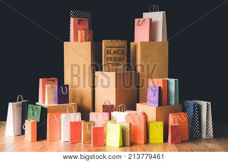 many shopping bags and little shopping cart black friday concept