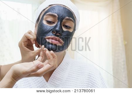 After having facial mud mask for a spa treatment her face being peeling off