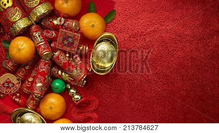 Chinese coins or Chinese knot of luck and chinese firecrackers and Chinese gold ingots and Traditional chinese knot (Foreign text means blessing) and Red envelopes and decoration with Fresh oranges on Red Paper background poster
