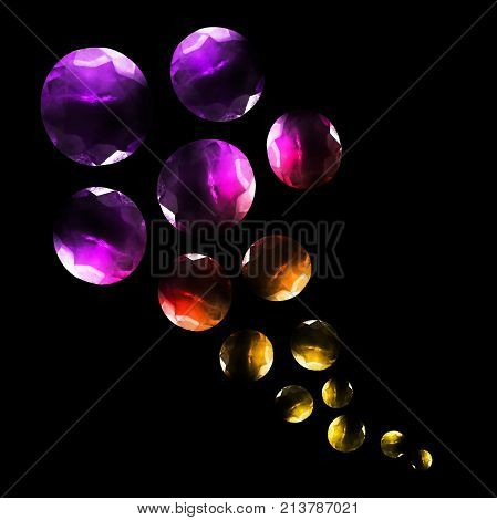Group of large and small colorful gems isolated over black